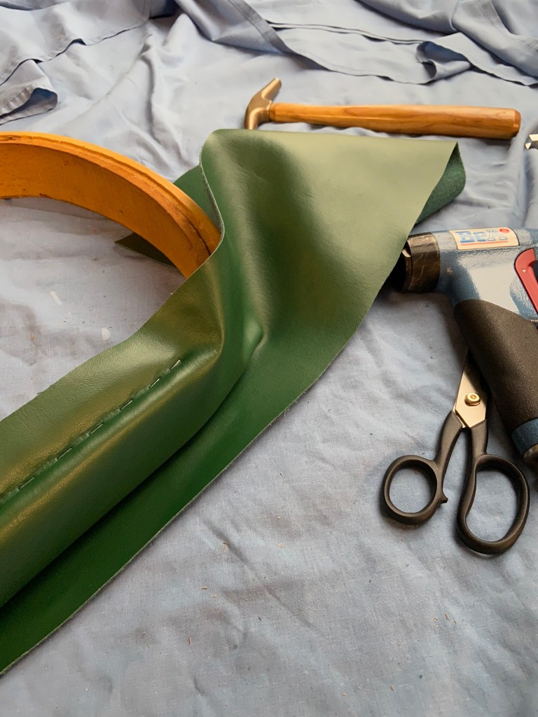 Smart new faux leather being attached.