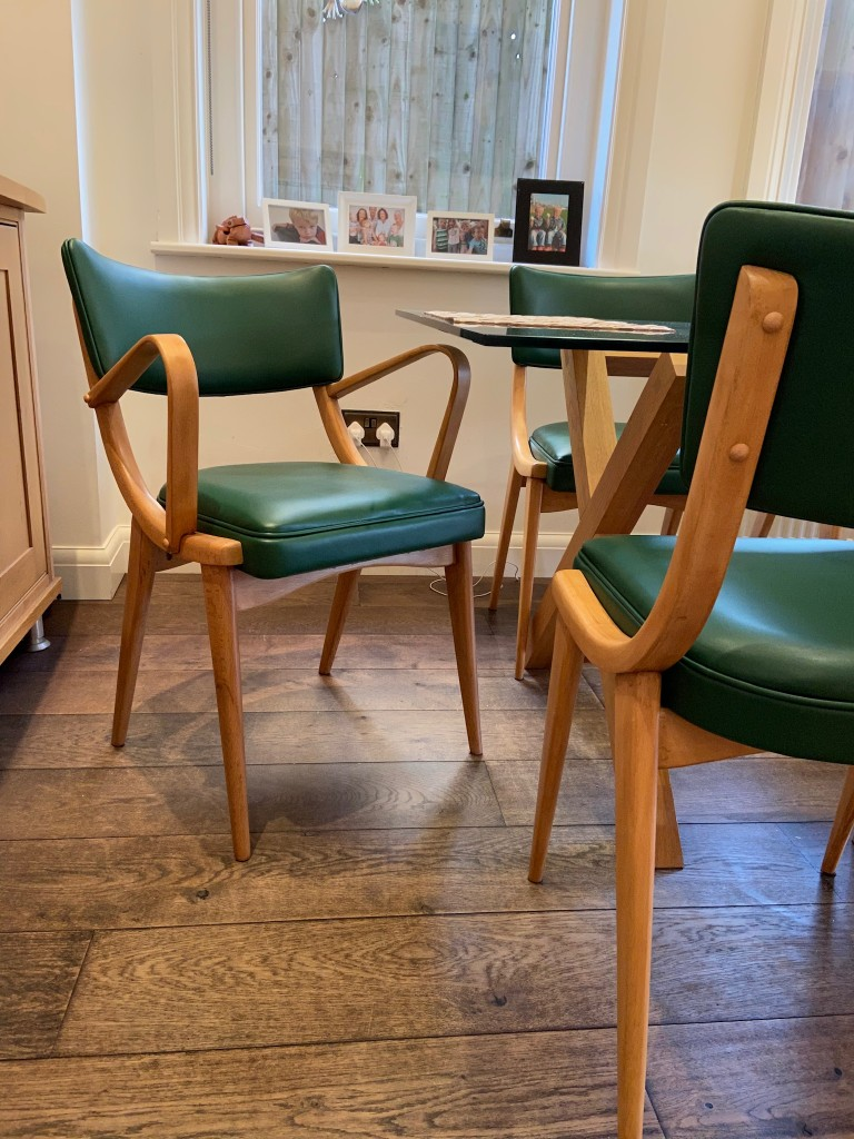 Ben Chairs complete in green Faux Leather